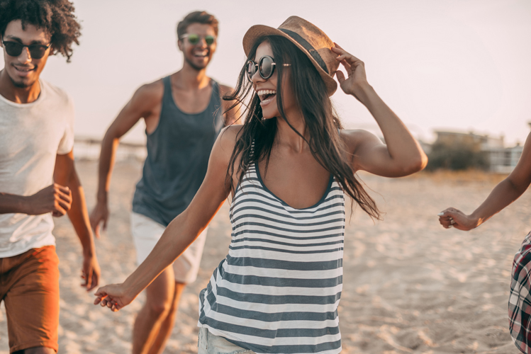 group laughing at beach