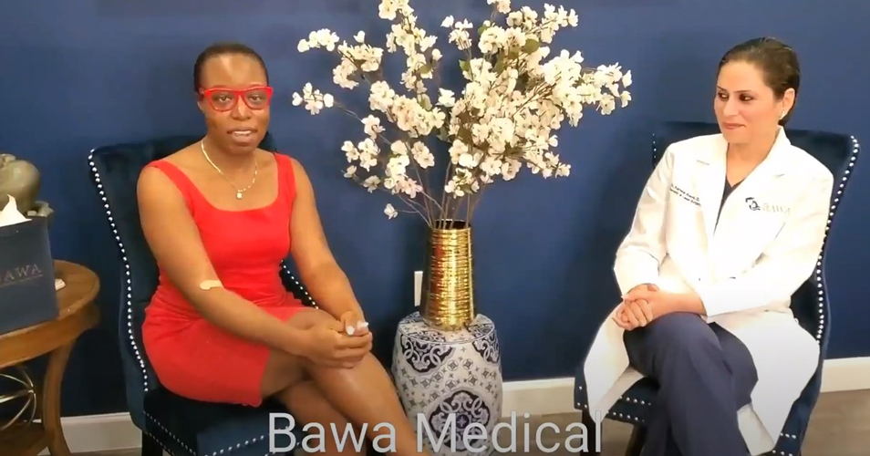 Dr. Bawa talking with patient