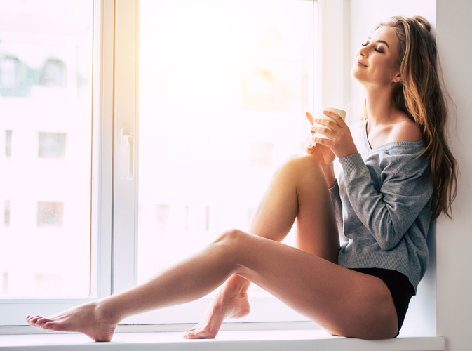 woman posing in window