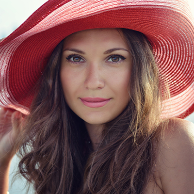 woman smiling with red hat